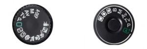 Volič expozičního režimu amatérské digitální zrcadlovky (nalevo) obsahuje celou škálu automatických scénických režimů. Naproti tomu u profesionální třídy fotoaparátů (napravo) tyto začátečnické režimy nenajdete. Zato máte k dispozici uživatelské režimy, které si můžete sami naprogramovat.jpg