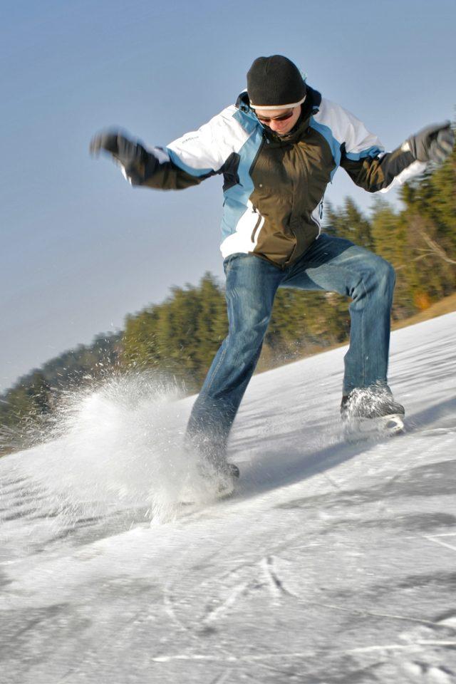 Jak fotit zimní sporty: snímek bruslaře s kompenzací expozice.
